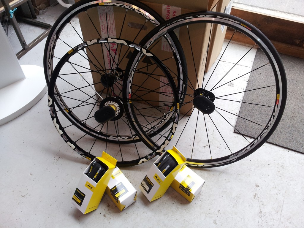 Most of Mavic's road wheels come with tyres supplied. Good tyres too!
